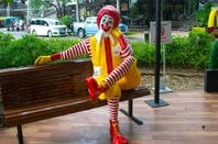 Ronald McDonald character sitting on the couch at Mccafe Star Avenue  in Bangkok ,Thailand