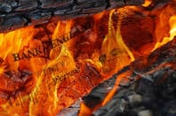 Burning a £20 note. Pic: Shutterstock