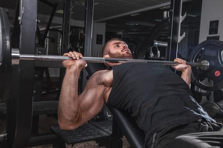 Man benchpress weights.