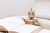 Robot reading photo via Shutterstock