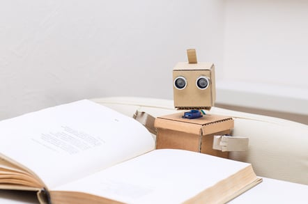 Robot reading photo via Shutterstock