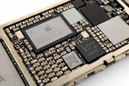 Close-up image of power management IC chip on an iPhone 6 logic board.
