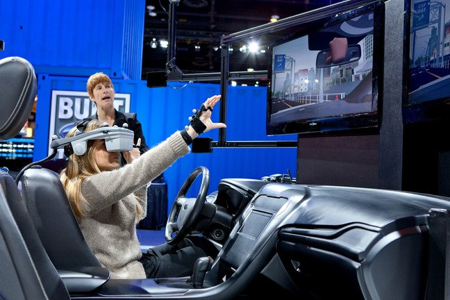 A Ford employee demonstrates a new virtual reality technology at the 2012 Chicago Auto Show Media Preview on February 9, 2012 in Chicago, Illinois.
