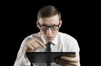man looks confused using ipad