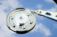 Disk drive with cloud reflected on platter