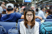woman waits at airport