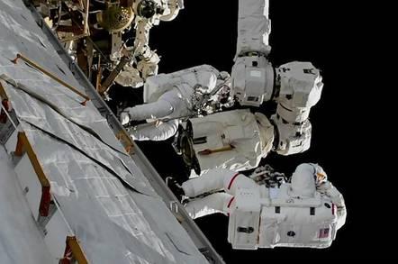 Spacewalkers repairing Canadarm2