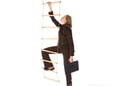 Woman attempts to climb rope ladder in business suit