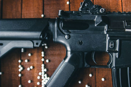 Airsoft rifle closeup with pellets