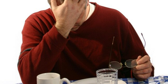 depressed man dines at empty plate