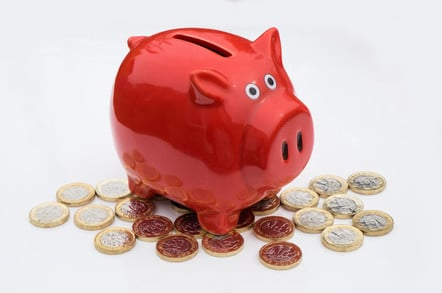 A piggy bank in a pile of pound coins