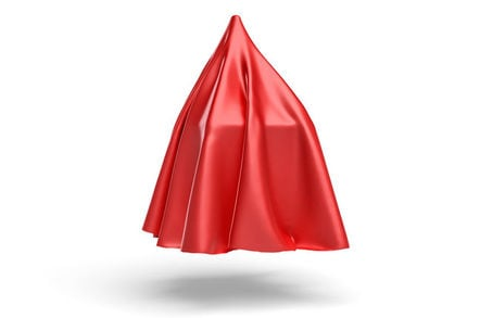 Red satin cloth obscuring object underneath