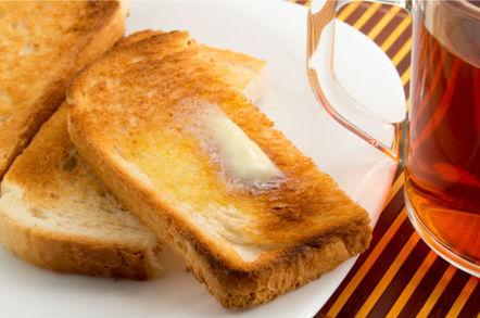 Tea mug wth buttered toast on a plate