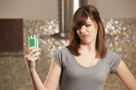woman drinks vile green liquid