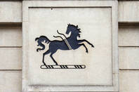 Lloyd's Horse logo on building