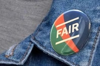 "The proposed badge on Martha lane Fox's doteveryone site. Jean jacket with a round lapel badge reading ""fair"""
