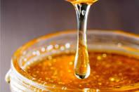 Syrup flows into jar