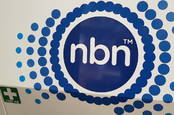 NBN truck side with First Aid sticker