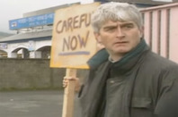 "Father Ted protests with ""down with this sort of thing"" placard."