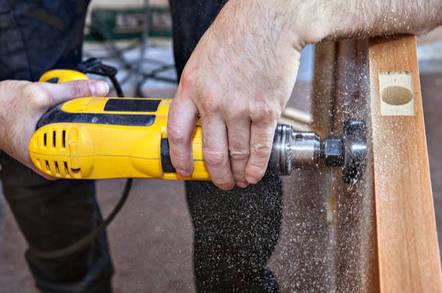 Installing a deadbolt drillbit in the door frame
