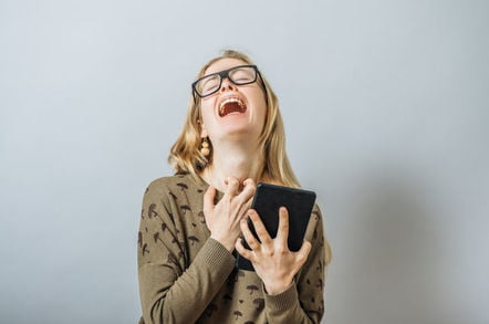 Woman wails in despair while clutching a tablet.