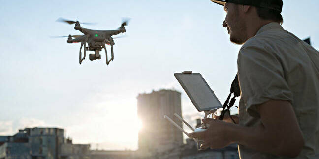 A man flying a drone. Pic: Shutterstock