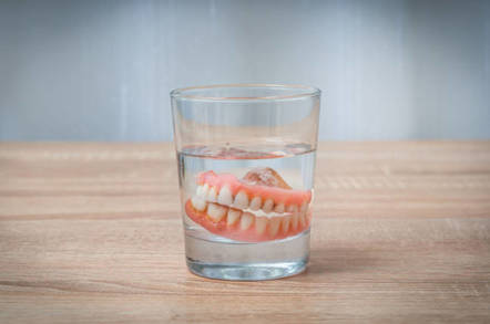 False teeth in glass