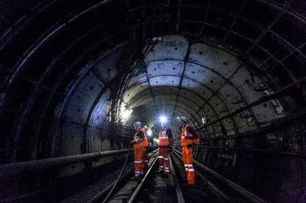 Installing cables on London Underground