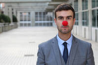 Business man dressed as a clown