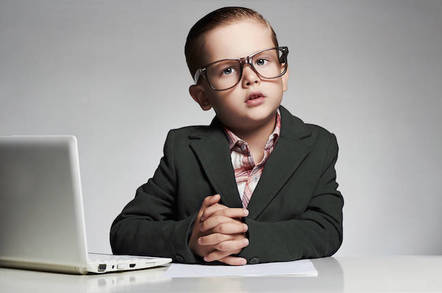 Child wearing a suit and using a computer