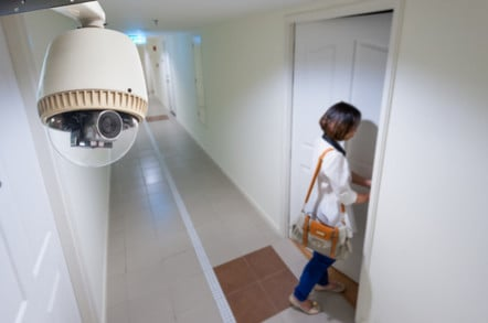 woman on camera as she enters her home