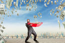 man gathers money in an umbrella