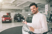 A car salesman shows you a range of cars