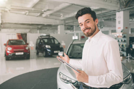 A car salesman shows you a range of cars