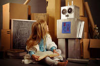 child with cardboard robot