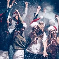 Young folk partying in Christmas hats