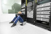 Sad man in server room