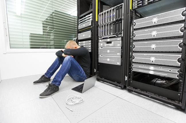 Sad man in server room