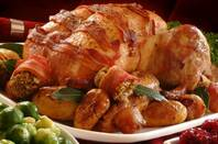 Christmas turkey wrapped in bacon with Brussels sprouts on the side