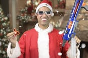 ajit pai in a santa suit