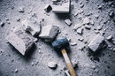 sledgehammer reduces cement block to powder