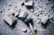 sledgehammer reduces cement block to powder