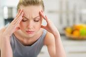 headache woman rubs temples