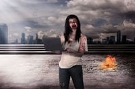 Possibly zombie woman holds laptop as blood runs down face in post apocalyptic future...