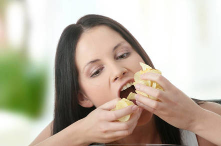 woman eating crisps with both hands