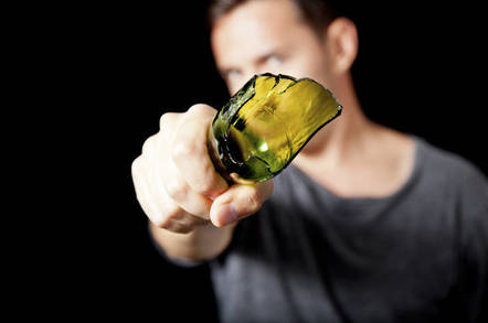 Man brandishing broken bottle