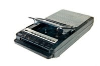 old Cassette Tape player and recorder on a white background... the play and record keys are blurred from use.