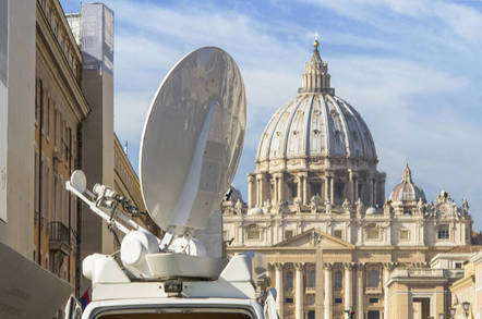 A picture of a satellite dish next to St Peter's Dome