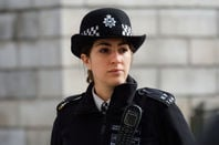 Metropolitan police person with motorola emergency comms device