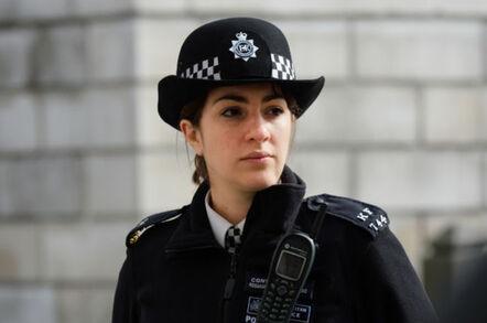 Metropolitan police person with motorola emergency comms device